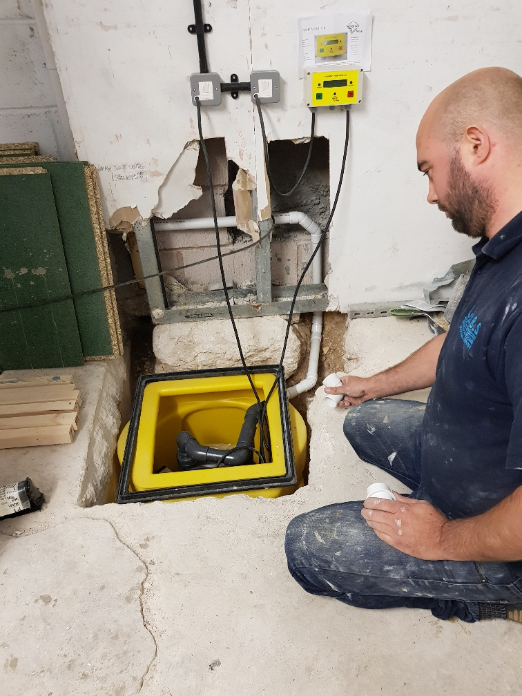 installing a sump and pump in a cellar conversion